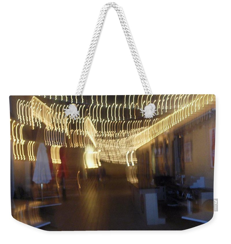 Photograph Weekender Tote Bag featuring the photograph Courtside Lounge by Thomas Valentine