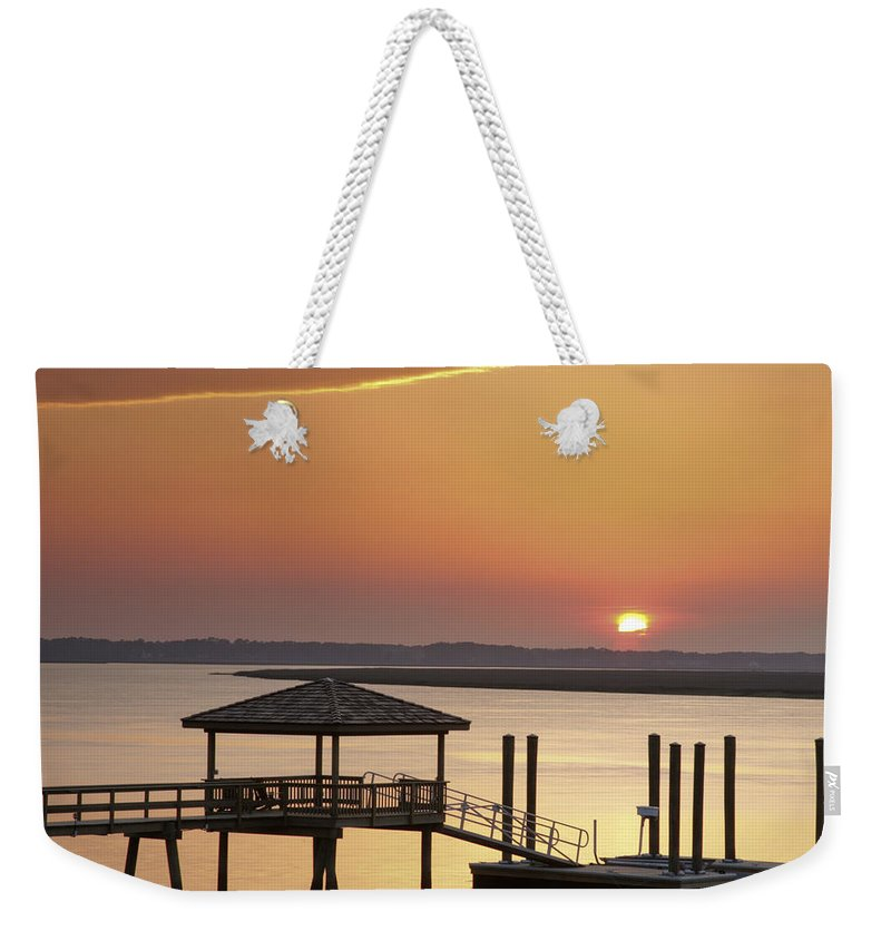 Sunset Weekender Tote Bag featuring the photograph Covered Dock by Phill Doherty