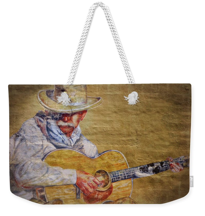 Cowboy Weekender Tote Bag featuring the photograph Cowboy Poet by Joan Carroll