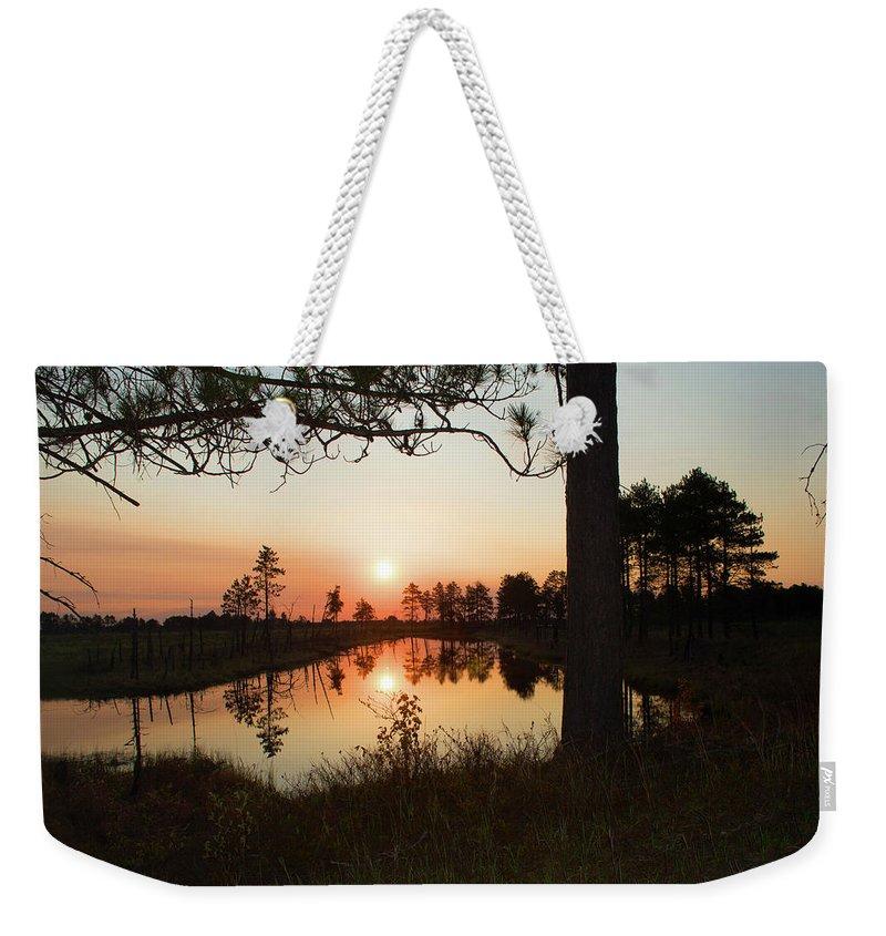 Seney National Wildlife Refuge Weekender Tote Bag featuring the photograph Crack Of Dawn by Linda Kerkau