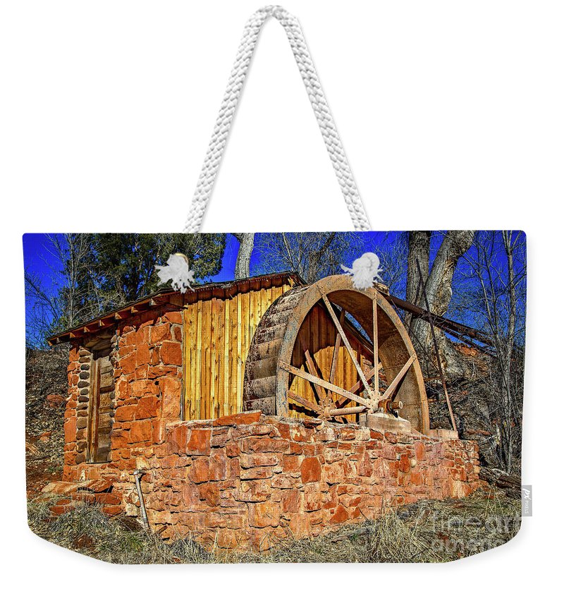 Jon Burch Weekender Tote Bag featuring the photograph Crescent Moon Ranch Water Wheel by Jon Burch Photography