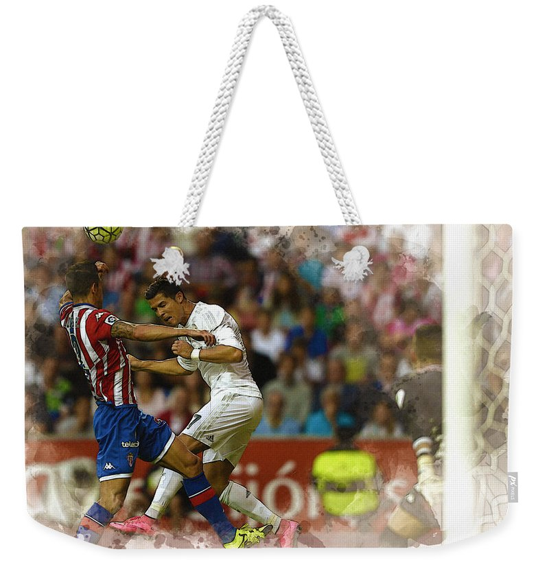 Uefa Chamipons League Weekender Tote Bag featuring the digital art Cristiano Ronaldo Heads The Ball During The Spanish League Footb by Don Kuing