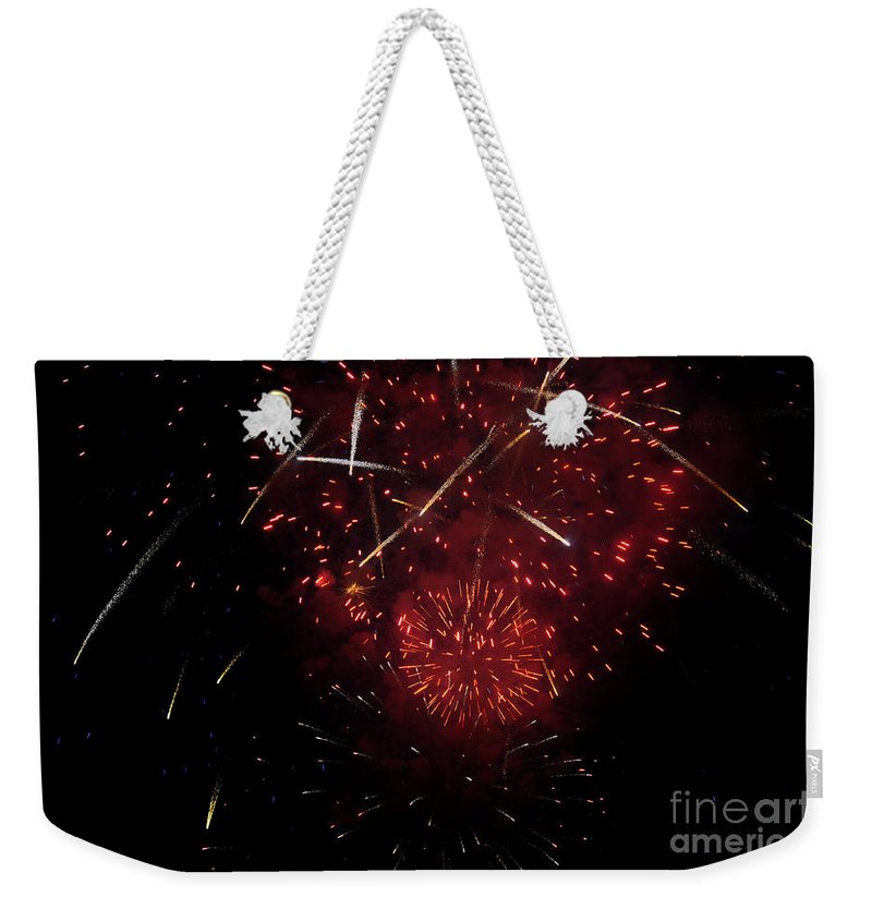 Clay Weekender Tote Bag featuring the photograph Cross Fire by Clayton Bruster