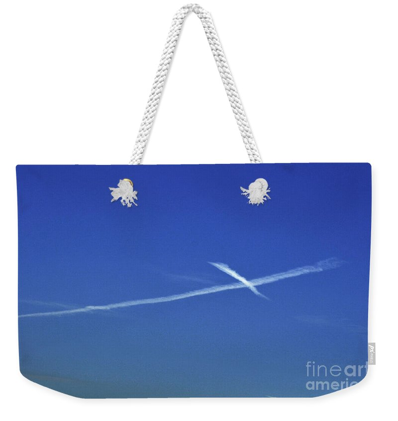 Clay Weekender Tote Bag featuring the photograph Cross In The Sky by Clayton Bruster