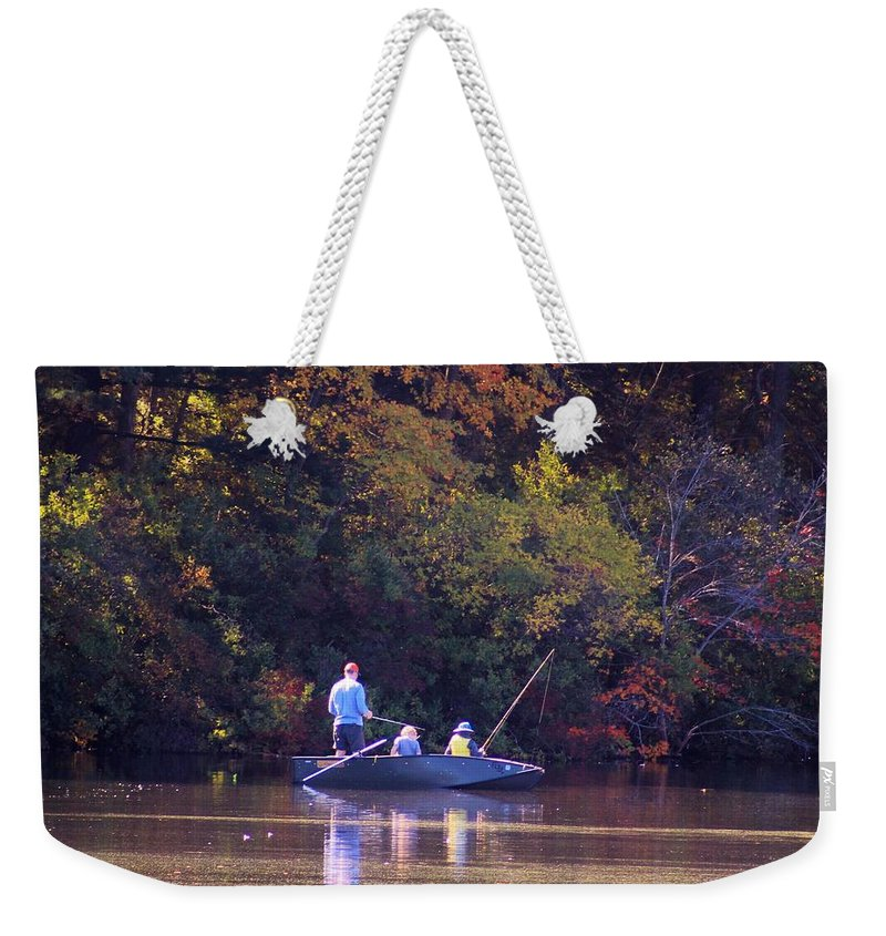 Boat Weekender Tote Bag featuring the photograph Dad And Sons Fishing by Karen Silvestri