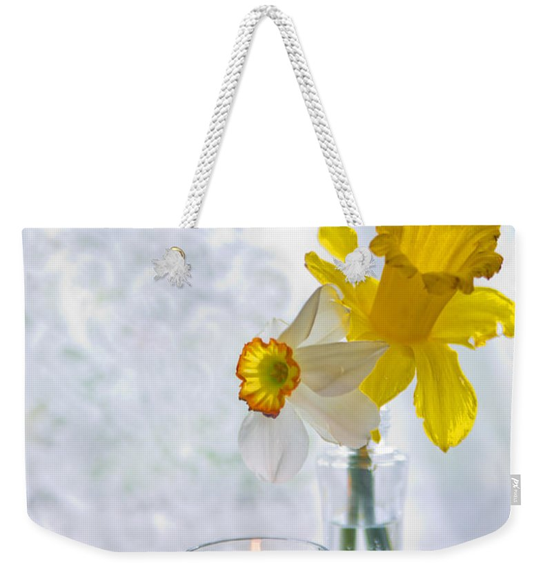 Daffodils Weekender Tote Bag featuring the photograph Daffodils And The Candle by Alex Art and Photo