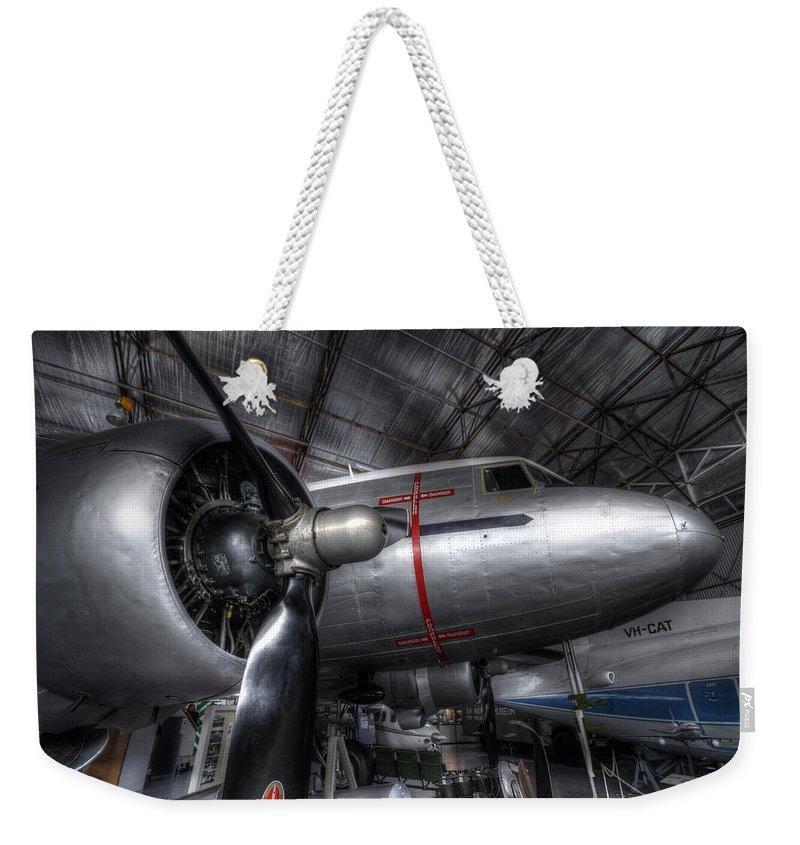 Plane Weekender Tote Bag featuring the photograph Dakota by Wayne Sherriff