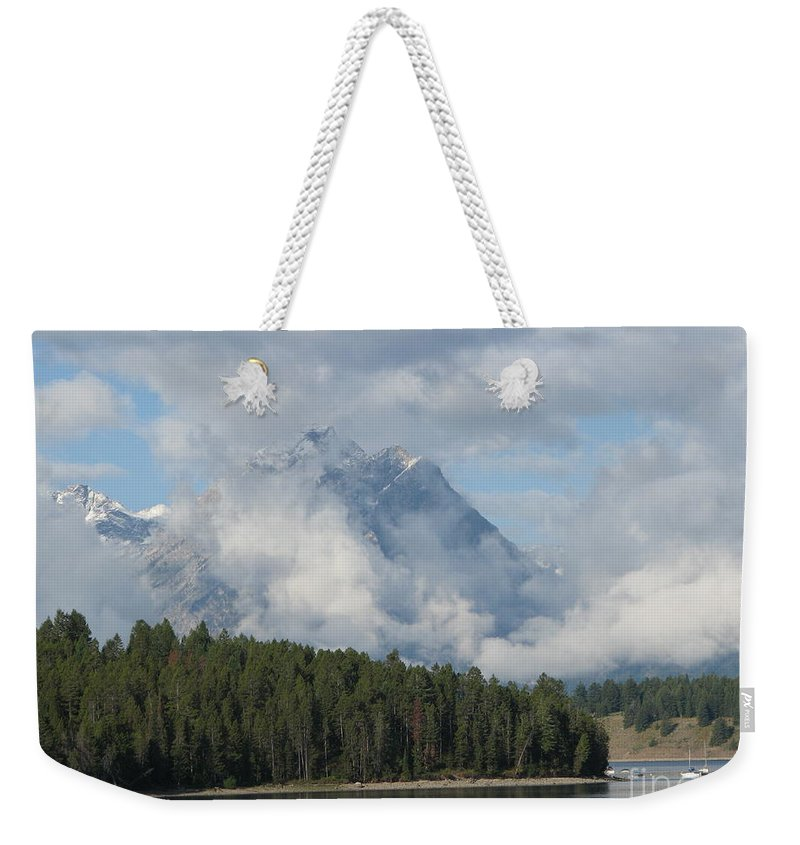 Patzer Weekender Tote Bag featuring the photograph Dam Clouds by Greg Patzer