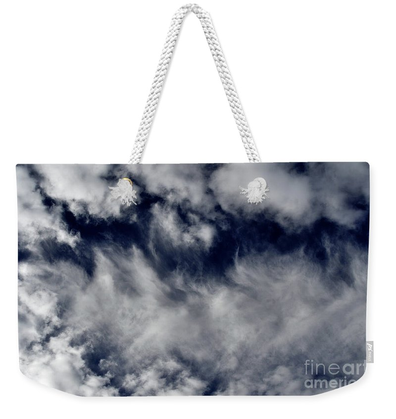 Clay Weekender Tote Bag featuring the photograph Dancing Clouds by Clayton Bruster