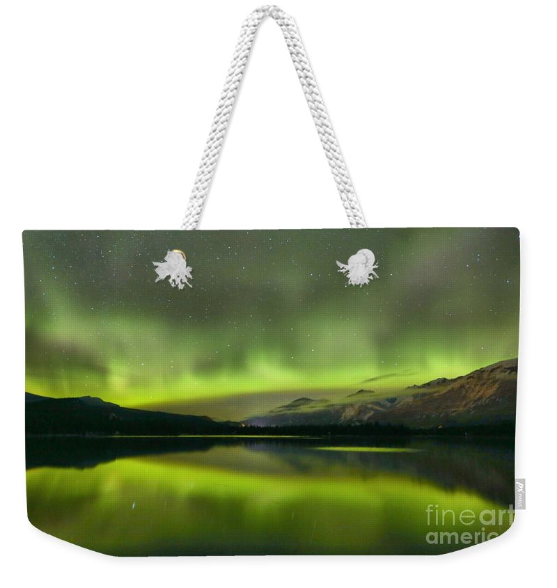 Northern Lights Weekender Tote Bag featuring the photograph Dancing Northern Lights by Adam Jewell