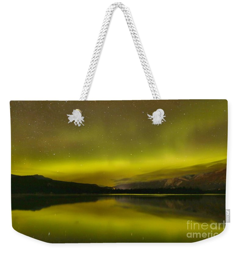 Northern Lights Weekender Tote Bag featuring the photograph Dancing Skies Over Edith Lake by Adam Jewell