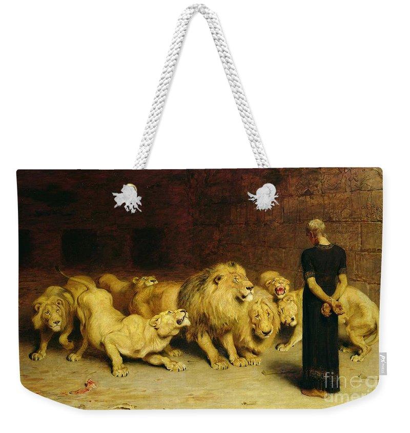 Daniel In The Lions' Den Weekender Tote Bag featuring the painting Daniel In The Lions Den by Briton Riviere