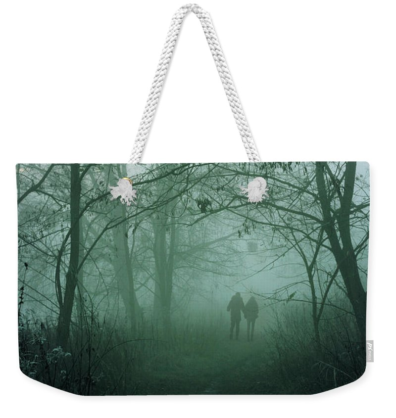 Dark Weekender Tote Bag featuring the photograph Dark Paths by Cambion Art