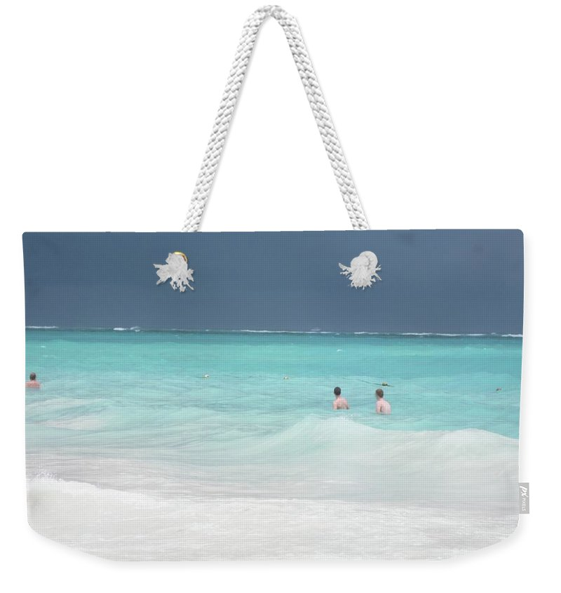 Ocean Weekender Tote Bag featuring the photograph Dark Skies Over Aquamarine Washed Waves by Cynthia Iwen
