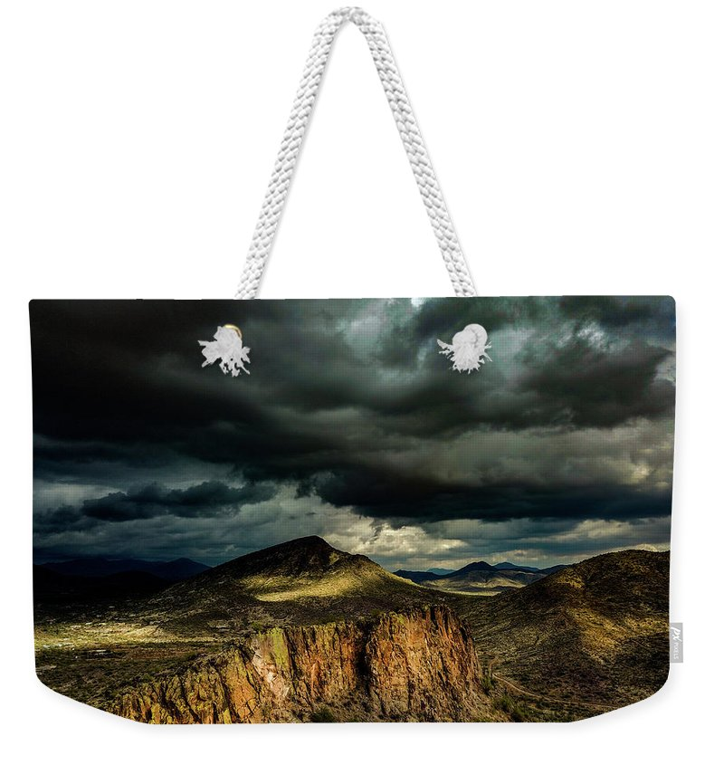Drone Photography Weekender Tote Bag featuring the photograph Dark Storm Clouds Over Cliffs by David Stevens