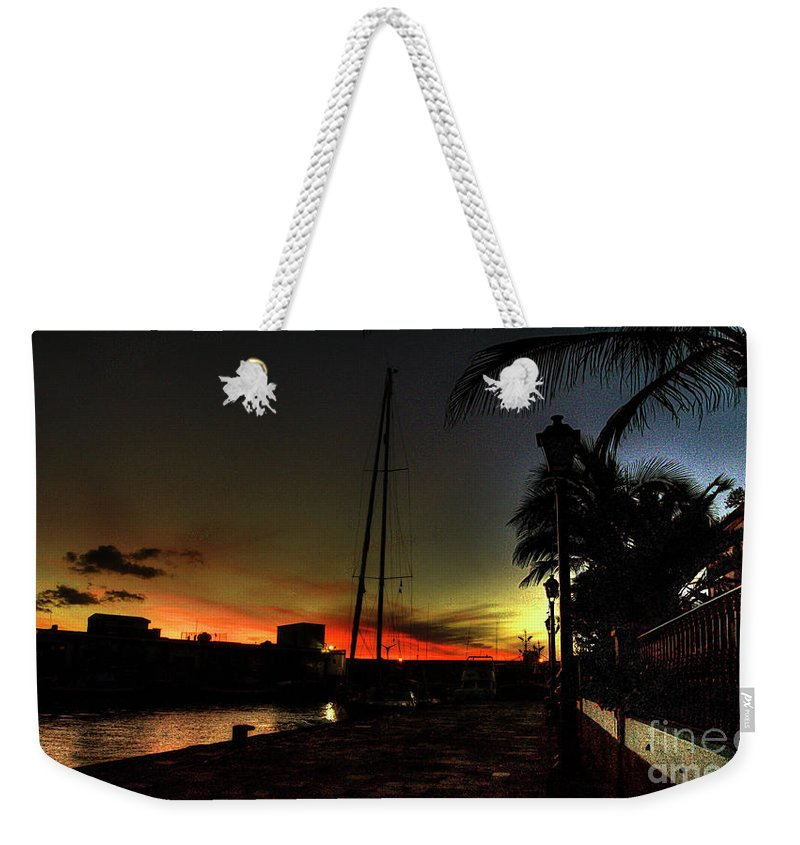 Puerto Weekender Tote Bag featuring the photograph Dark Sunlight by Rob Hawkins