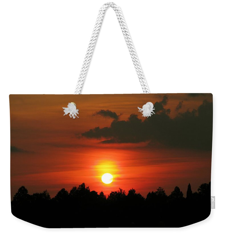 Nature Weekender Tote Bag featuring the photograph Dark Sunset by Peg Urban