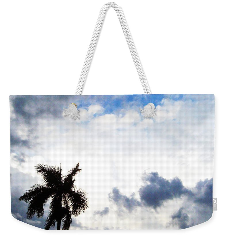 Florida Weekender Tote Bag featuring the photograph Darkness Moving In by Chris Andruskiewicz