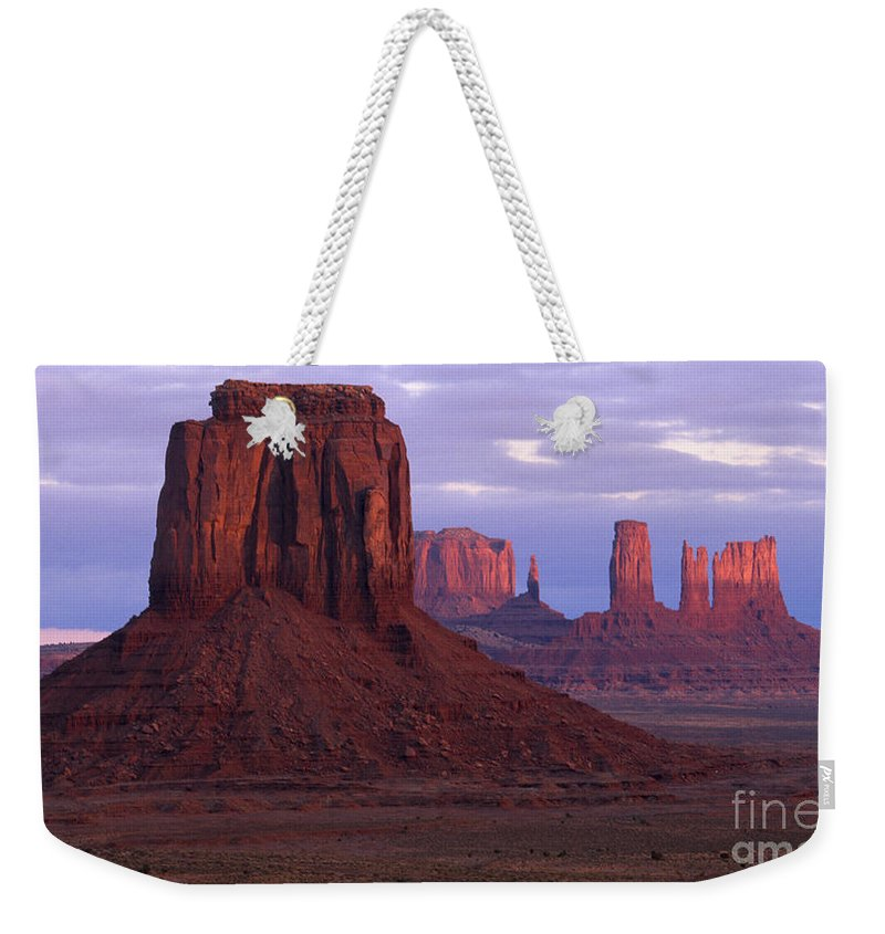 Monument Valley Weekender Tote Bag featuring the photograph Dawn At Monument Valley by Sandra Bronstein