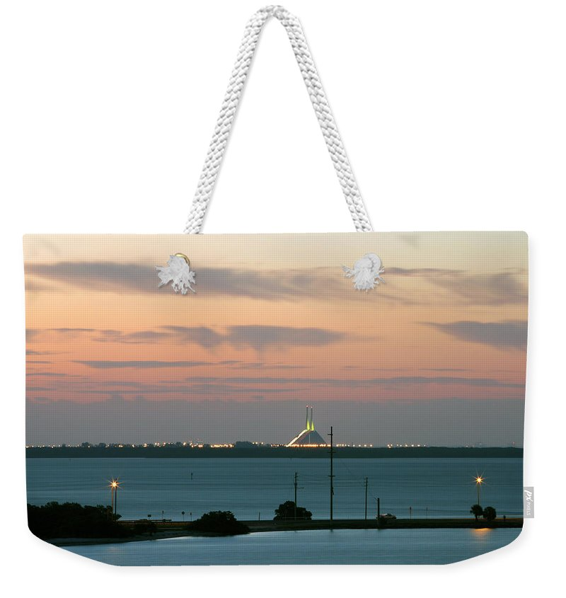Sunshine Weekender Tote Bag featuring the photograph Dawn At The Sunshine Skyway Bridge Viewed From Tierra Verde Florida by Mal Bray
