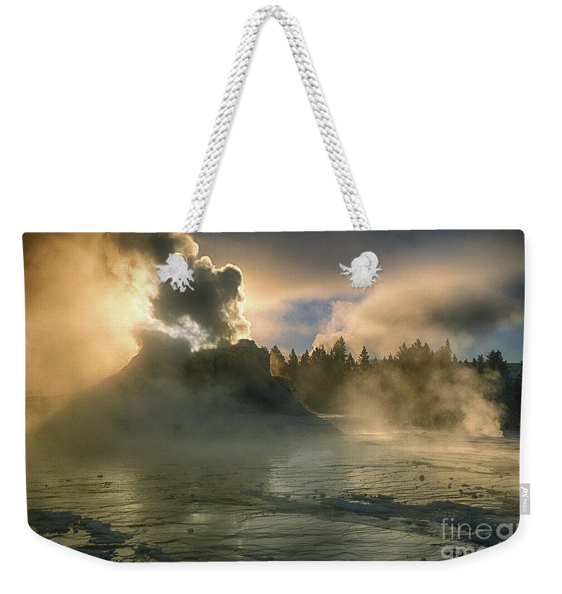 Yellowstone Weekender Tote Bag featuring the photograph Dawn On Castle Geyser by Sandra Bronstein