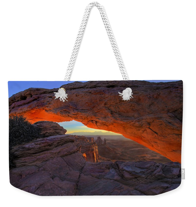 Mesa Arch Weekender Tote Bag featuring the photograph Dawns Early Light by Mike Dawson
