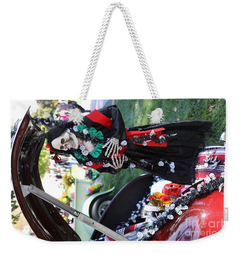 Dia De Los Muertos Weekender Tote Bag featuring the photograph Day Of The Dead Car Trunk Skeleton by Chuck Kuhn