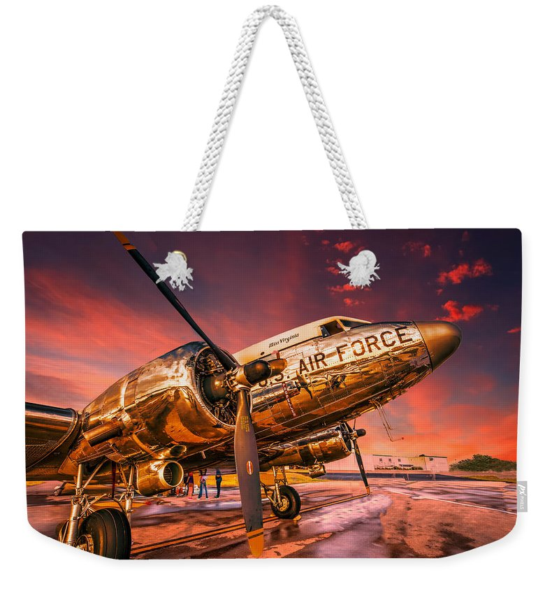 Aircraft Weekender Tote Bag featuring the photograph Dc-3 In Surreal Evening Light by Philip Rispin
