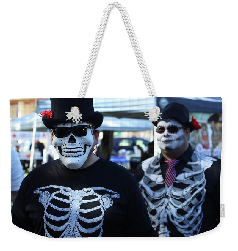 Dia De Los Muertos Weekender Tote Bag featuring the photograph Dead Alive Skeletons by Chuck Kuhn