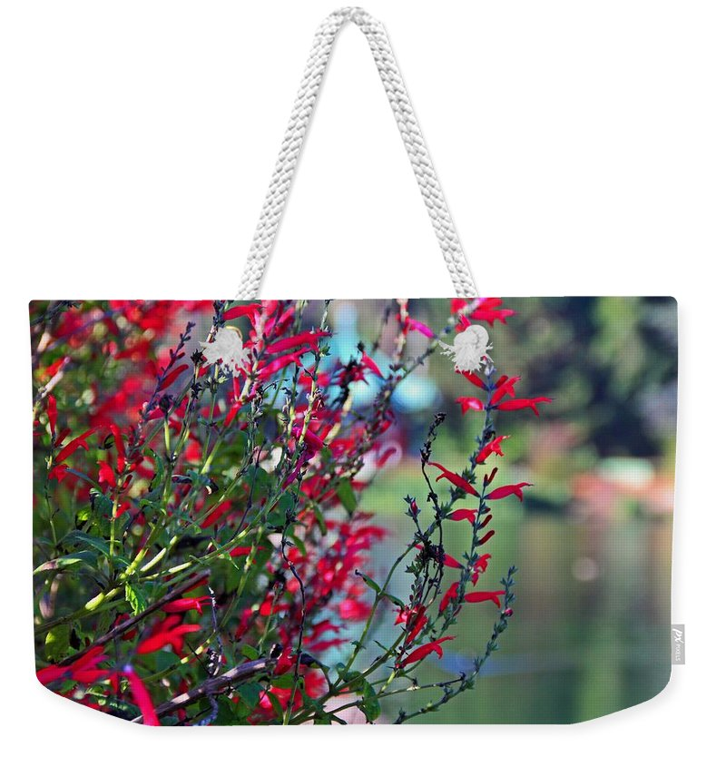Red Weekender Tote Bag featuring the photograph Decades Of Desire by Michiale Schneider