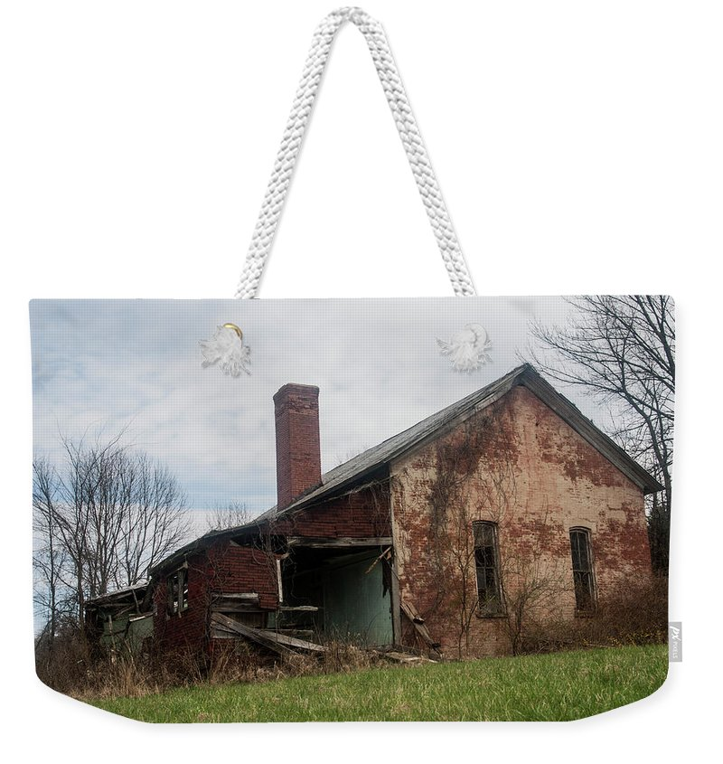 Weekender Tote Bag featuring the photograph Decaying Knowledge by Melissa Newcomb