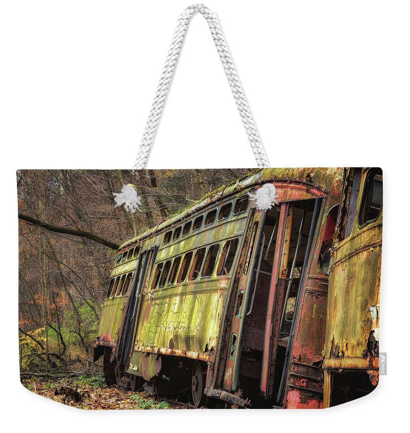 Trolley Weekender Tote Bag featuring the photograph Decaying Trolley Cars by Ken Curtis