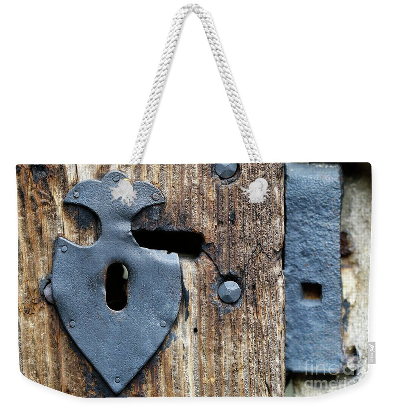 Key Weekender Tote Bag featuring the photograph Decorative Door Fittings by Michal Boubin