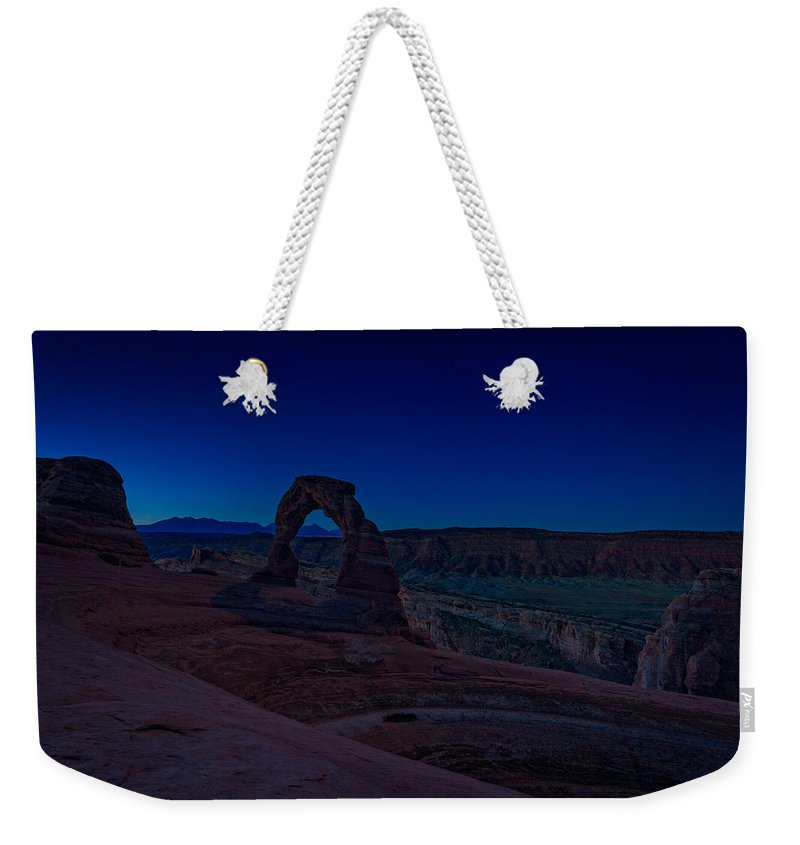Delicate Arch Weekender Tote Bag featuring the photograph Delicate Arch In The Blue Hour by Rick Berk