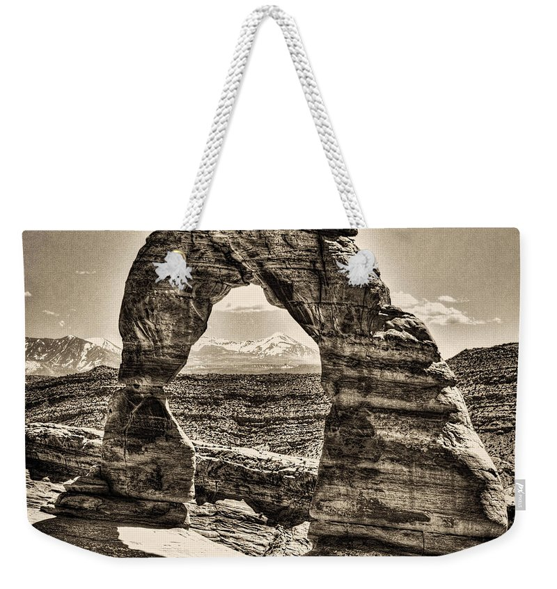 Pictorial Weekender Tote Bag featuring the photograph Delicate Arch by Roger Passman