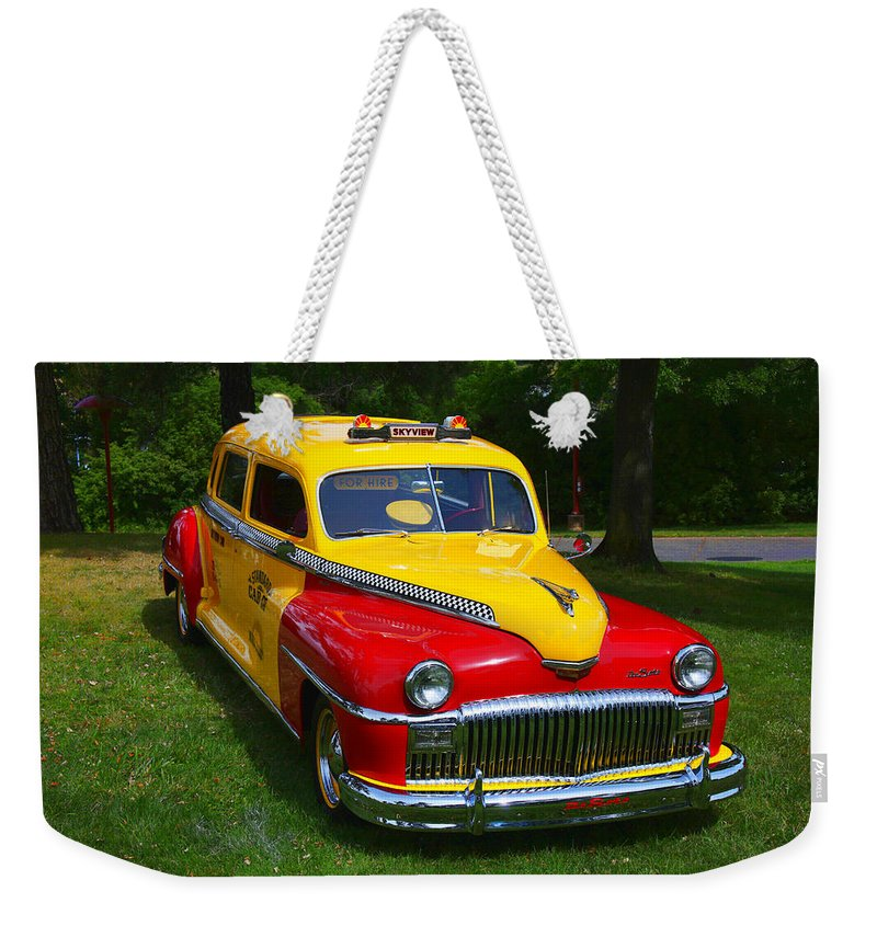 Desoto Skyview Taxi Weekender Tote Bag featuring the photograph Desoto Skyview Taxi by Garry Gay
