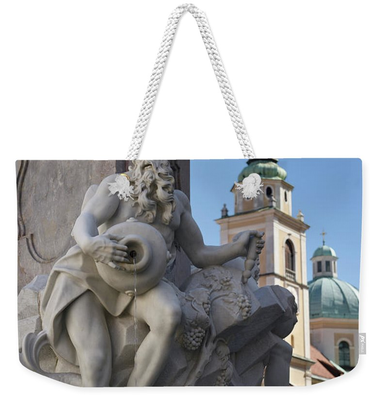 Detail Weekender Tote Bag featuring the photograph Detail Of The Robba Marble Scultpure On The Fountain Of The Thre by Reimar Gaertner