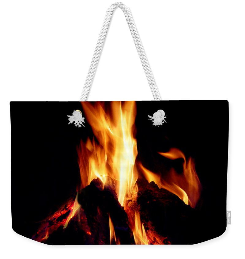 Devil Weekender Tote Bag featuring the photograph Devil Fire by Peter Piatt