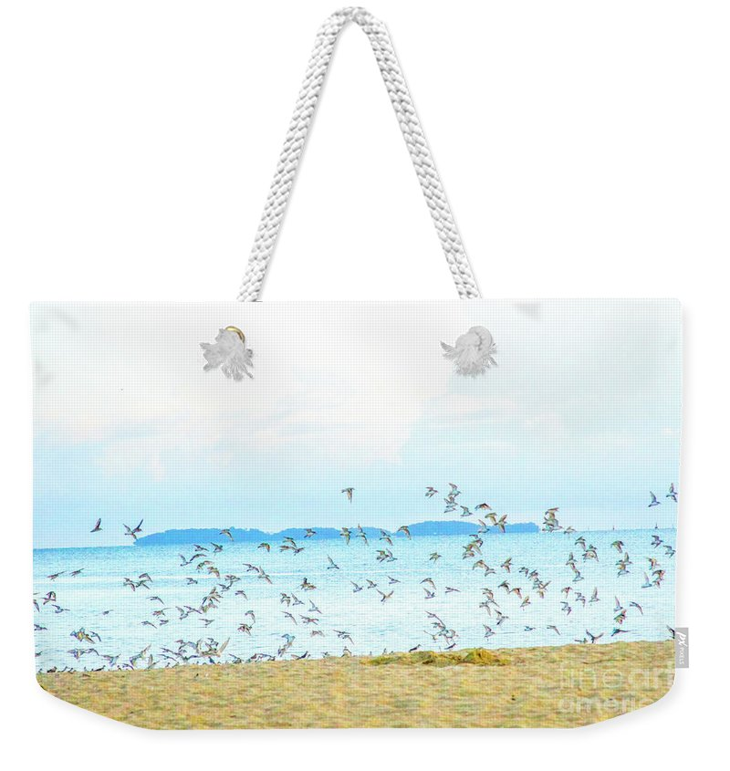 Devil's Island Weekender Tote Bag featuring the photograph Devil's Island by Carmin Wong