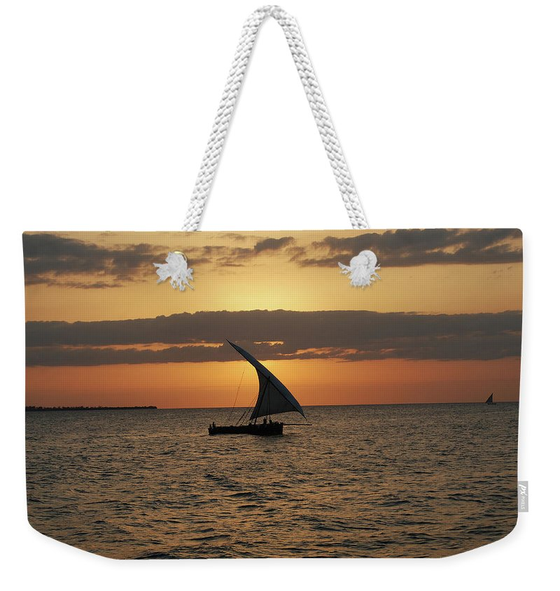 Zanzibar Weekender Tote Bag featuring the photograph Dhow At Sunset by Harvey Barrison