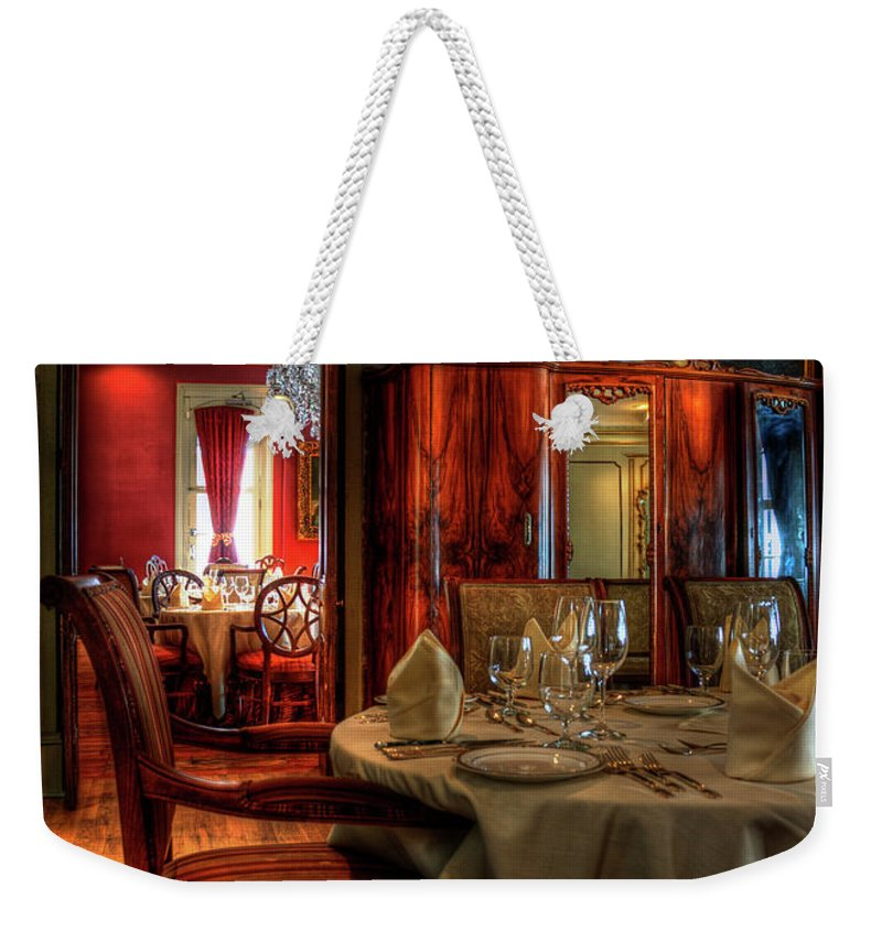 New Orleans Weekender Tote Bag featuring the photograph Dining At Muriel's by Kathleen K Parker