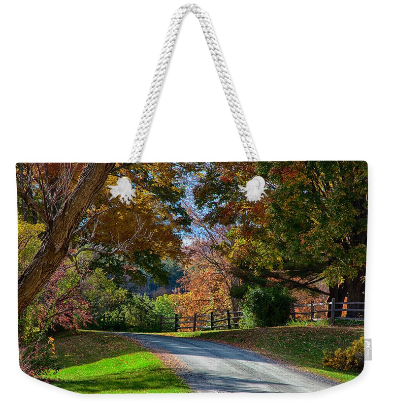 #jefffolger Weekender Tote Bag featuring the photograph Dirt Road Through Vermont Fall Foliage by Jeff Folger