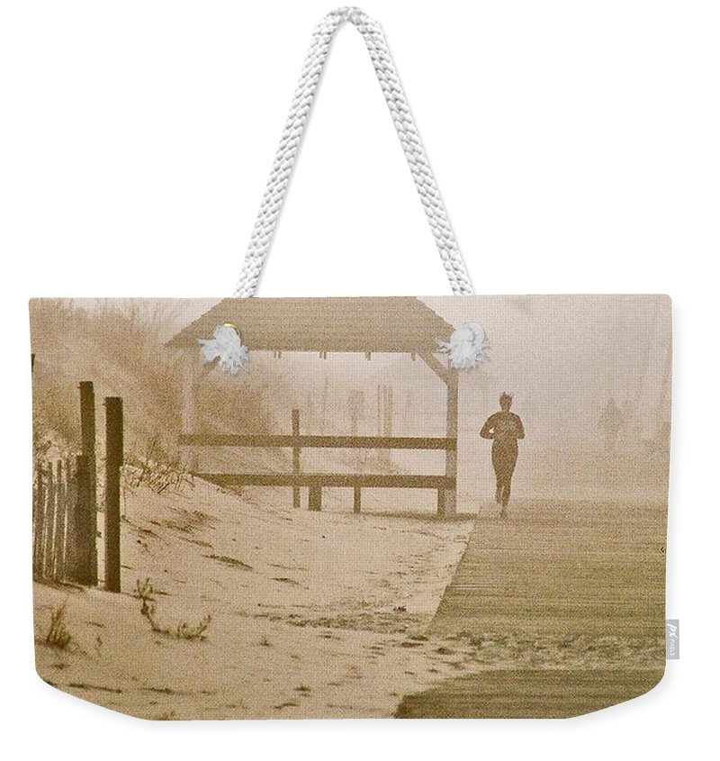 Landscape Weekender Tote Bag featuring the photograph Disappearance by Steve Karol
