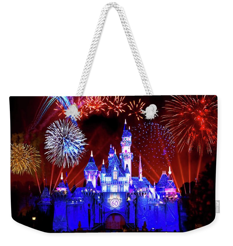 Disneyland Weekender Tote Bag featuring the photograph Disneyland 60th Anniversary Fireworks by Mark Andrew Thomas