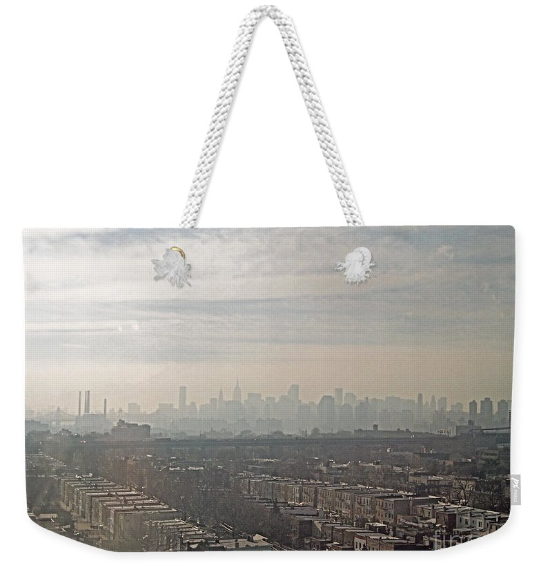 Brooklyn Weekender Tote Bag featuring the photograph Distant City by Paulette B Wright