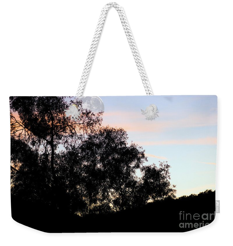 Clay Weekender Tote Bag featuring the photograph Distant Moon by Clayton Bruster