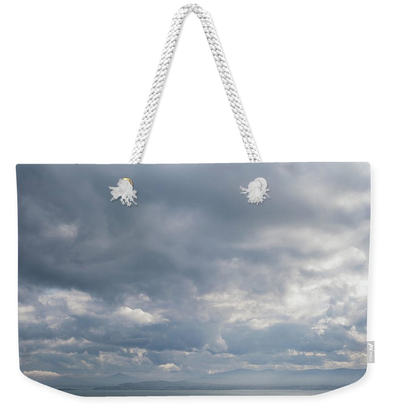 50mm Weekender Tote Bag featuring the photograph Distant Silhouette by Anton Lucic