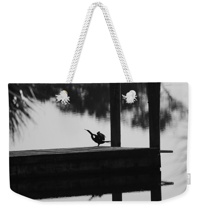 Dock Weekender Tote Bag featuring the photograph Dock Bird by Rob Hans