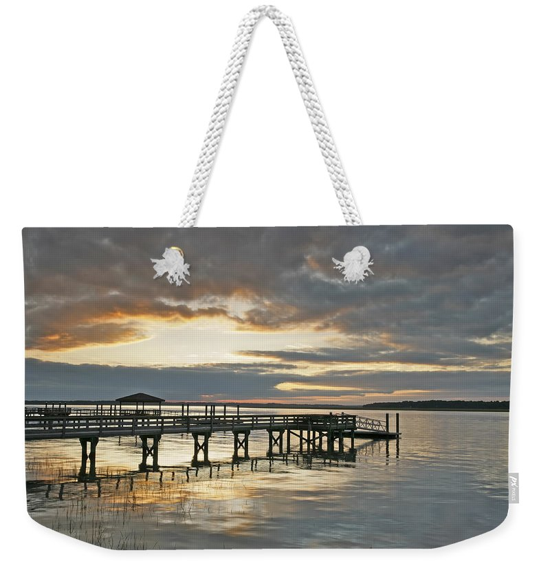 Sunset Weekender Tote Bag featuring the photograph Dock Reflections by Phill Doherty