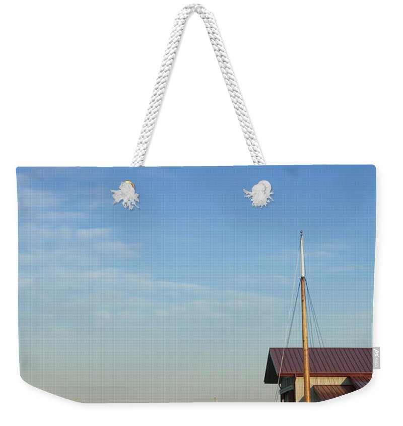 Boat Weekender Tote Bag featuring the photograph Docked by Bill Cannon